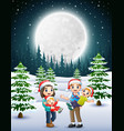 happy familly in the snowy garden at night vector image vector image
