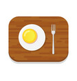 omelette on wooden cutting board isolated vector image vector image