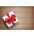 Present Gift Box with Bow on Wooden vector image vector image