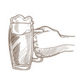 big mug of bear with foam in male hand vector image vector image