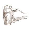 big mug of bear with foam in male hand vector image
