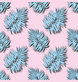 blue tropical leaves on a pink background vector image vector image