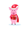 pig holding gift box wearing hat happy new year vector image vector image
