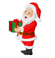 cartoon santa claus holding a gift vector image