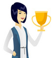 young asian business woman holding a trophy vector image vector image