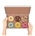 colorful donuts with glaze in open white box vector image vector image