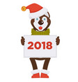 husky dog in christmas hat holds placard with 2018 vector image vector image