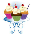 three cupcakes vector image vector image