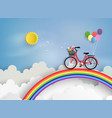 bicycle riding on a rainbow vector image