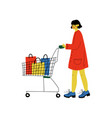 young woman walking with shopping cart girl vector image vector image