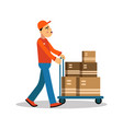 delivery man carrying boxes on a hand truck vector image