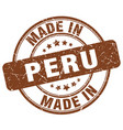 made in peru brown grunge round stamp vector image vector image