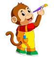 cute monkey holding paint brush
