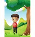 a boy under shade a big tree vector image vector image