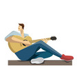 caucasian musician sitting with the guitar in vector image vector image