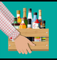 alcohol drinks collection in box in hand vector image