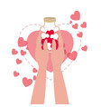hand with jar and hearts isolated icon vector image