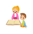 cute little kids sitting on the floor and reading vector image vector image
