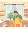 Man in apron cooking food in pan in kitchen