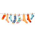 socks on rope cotton or wool sock dry and hang vector image vector image