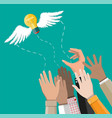 light idea bulb with wings flying away from hands vector image