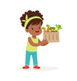 sweet black little girl holding basket full of vector image vector image