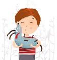 boy holding kissing dog portrait vector image