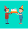 happy kids holding birthday cake with candles vector image