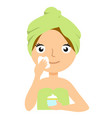 beautiful young woman applying facial mask spa vector image vector image