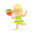 sweet blonde little girl running with bowl full of vector image vector image