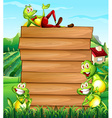Wooden board and frogs in the field vector image vector image