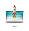 startup the rocket takes off from the laptop vector image