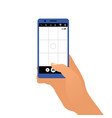 hand holding the smartphone and taking a photo vector image
