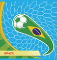 brazil waving flag and soccer ball in goal net vector image vector image