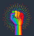 rainbow colored hand with a fist raised up gay vector image vector image