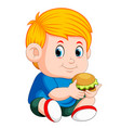 boy eating burger vector image