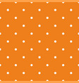 tile pattern with small white polka dots on orange vector image vector image