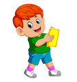 boy reading book with a smile vector image vector image