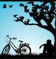 relaxing bicyclist under a tree vector image