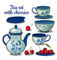 tea set and ripe cherry isolated on a white vector image vector image