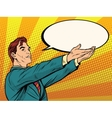 Retro businessman holding a comic bubble vector image vector image