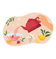 hand holding red teapot and pouring fresh tea vector image