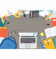 laptop with school supplies on desk top view vector image