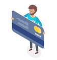 a happy man standing holding his credit card vector image