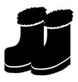 winter boots silhouette vector image vector image
