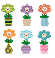 cute flowers in pots with smiley face vector image vector image
