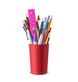 stationery are in red plastic cup pens pencils vector image vector image