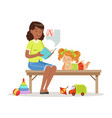 teacher reading a book to little girl while vector image vector image