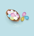 top view of colored easter eggs in basket vector image vector image