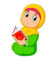 beautiful girl is holding al quran
